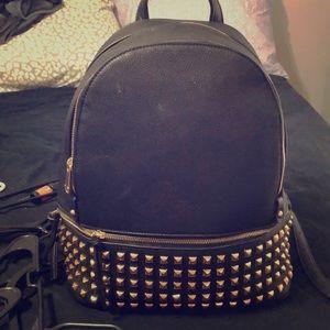 Handbags - Studded leather backpack purse